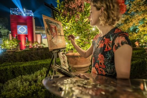 LARA Graduate Lydia Cecil painting by night at the New Generation Festival 2019